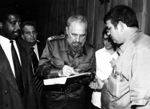 Fidel Castro signs a photo for Patrick Manteiga. The photo he's signing is a shot of Manteiga's grandfather in Tampa giving Castro money for the revolution. (Photo courtesy of Patrick Manteiga.)