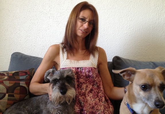 Marcia Brooks, 45, lives in Deerfield Beach with her two teens and two small dogs, Paco and Oliver. (Photo by Mc Nelly Torres)