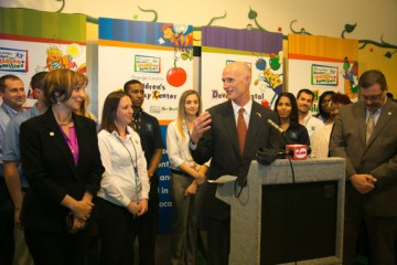 Gov. Rick Scott with child protective services and then-interim DCF chief Ester Jacobo. (Photo by Meredyth Hope Hall via FLGov.com)