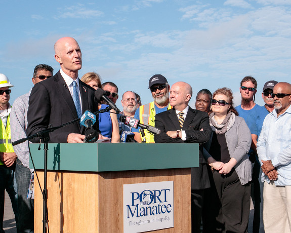 "Gov. Rick Scott, pictured here at Port Manatee on March 11, will need to adopt a ""climate change"" mitigation plan if he wants Florida to be eligible for FEMA funds. (Photo courtesy of Gov.Scott.)"