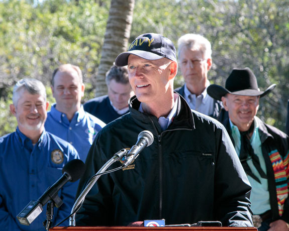 "Gov. Rick Scott, pictured here in the Everglades, has denied that he prohibits DEP employees from using the terms ""climate change"" and ""global warming."" (Photo courtesy of Gov. Scott.)"