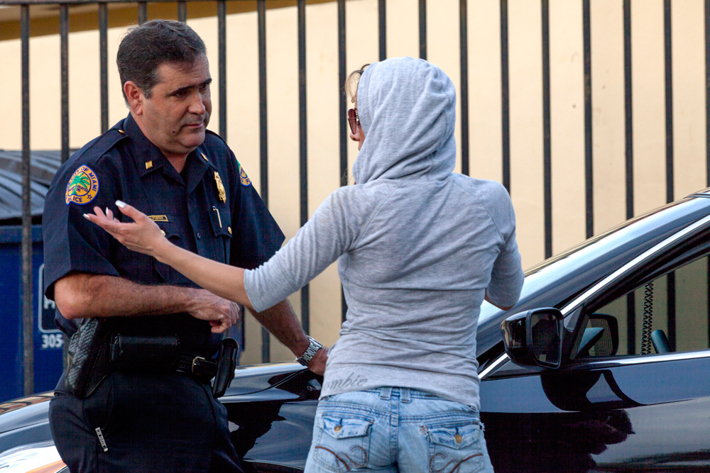 City of Miami Police Commander Jose Alfonso stops a suspected prostitute along SW 8th Street in Miami during the morning rush hour on Wednesday, July 15, 2015, so he could check for outstanding warrants and offer her an opportunity to say if she is being coerced or abused. Her record came up clean and she left. Until recently, Jose Alfonso was assigned to Miami-Dade State Attorney Katherine Fernandez Rundle's human trafficking unit. He won a national award in January for his work. Credit: John Van Beekum/FCIR
